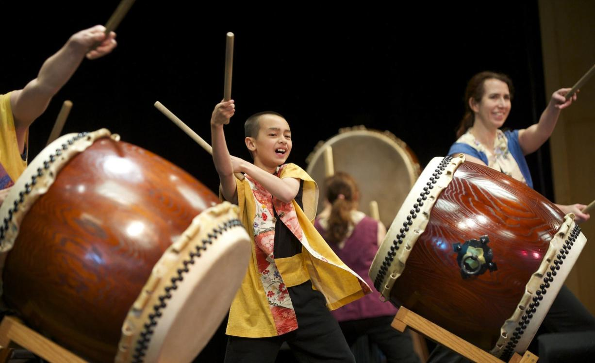 Photos by Steven Lane/The Columbian Portland Taiko Drum Group performs at the 10th annual Clark College Sakura Festival on Thursday.