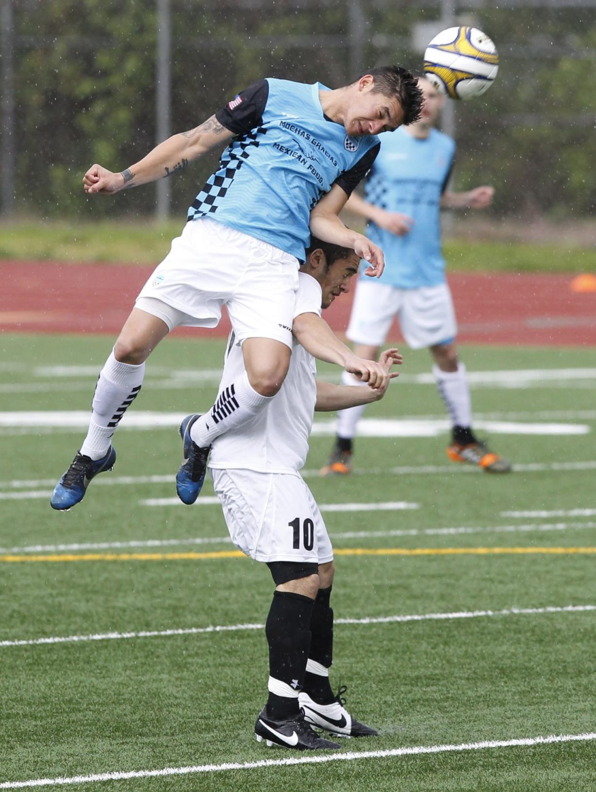 Vancouver's Bryanth Garcia-Junco heads ball over Westsound's Cameron Stone (10) during Sunday's 4-0 Vancouver victory.