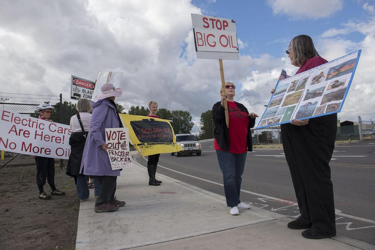 Pat Freiberg, second from right, and Carrie Parks, right, of Beyond Oil and Coal join a handful of fellow protesters near the Port of Vancouver's Terminal 5 on Thursday afternoon, Sept. 17, 2015.