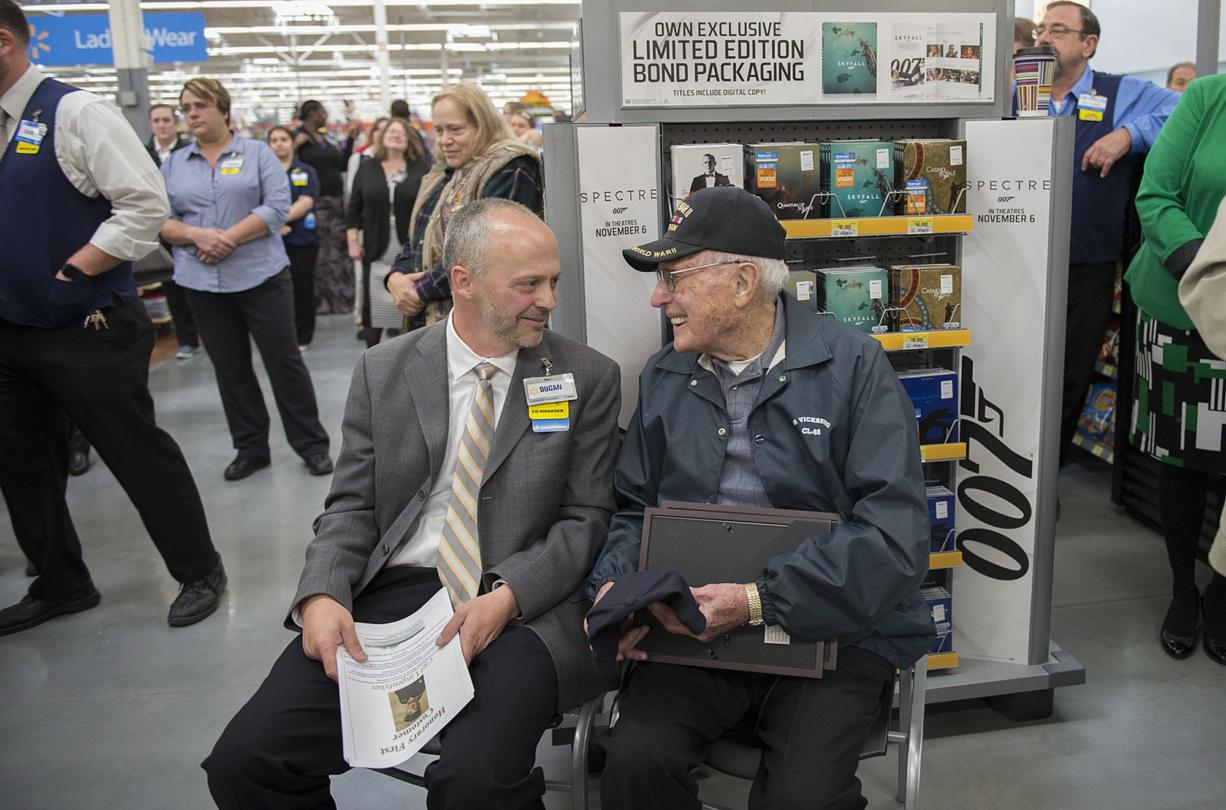Co-manager Dugan Harris, left, shares a smile with honorary first customer Carl Lingenfelter, who is a World War II veteran, after he was honored Wednesday morning at the new Wal-Mart in Orchards.