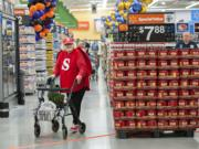 Wal-Mart employee Helen Crank greets shoppers dressed as an oversize Skittle while handing out free samples of the candy on Wednesday morning at the new Wal-Mart in Orchards.