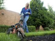 Carolene Carroll edges the lawn outside the CRESA offices Sept.