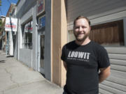 Devon Bray, co-owner of Loowit Brewing, stands in front of his business in downtown Vancouver.
