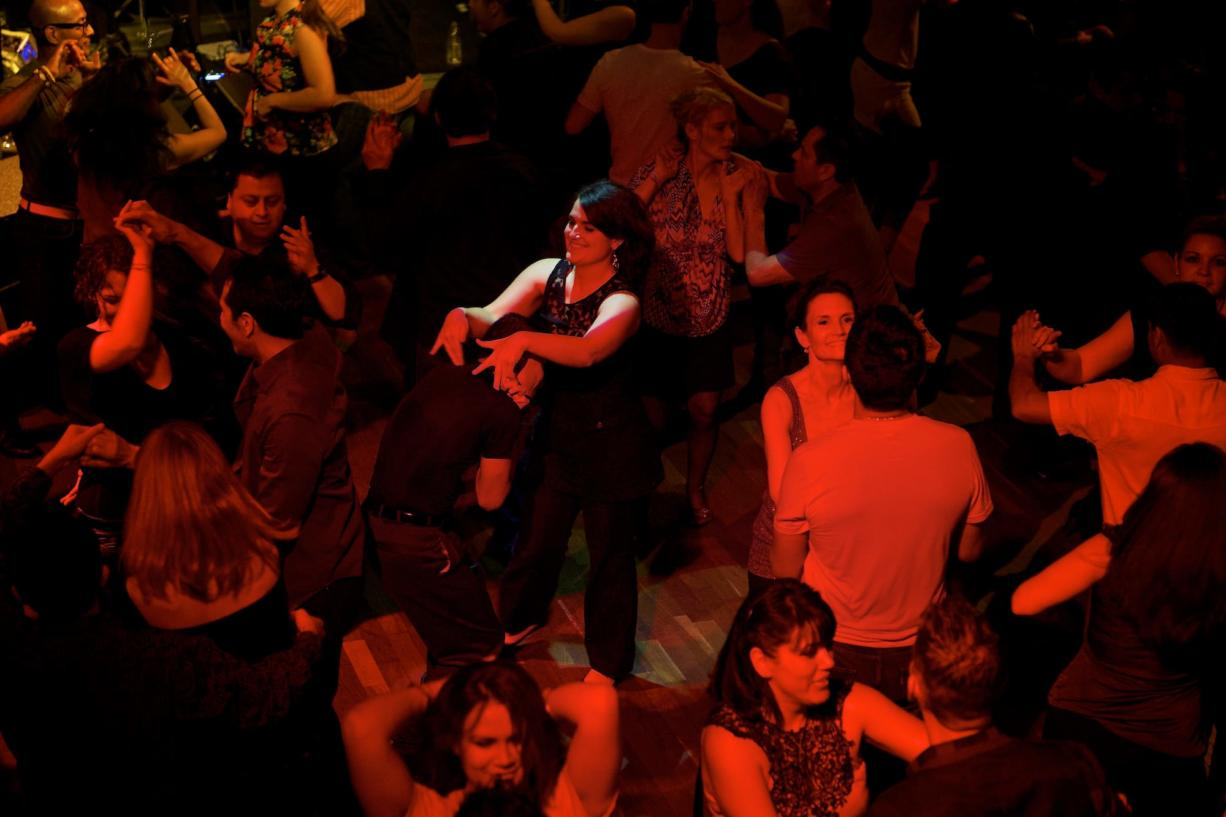 """April Haydon fell in love with salsa dancing while studying abroad. Here, she dances with Alberto Mejia at Portland's Conga Club. """"Every culture has its own wealth of knowledge and its own ways of doing things,"""" she said."""