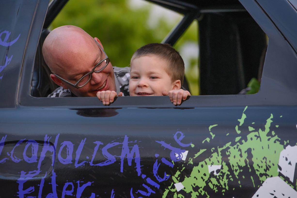 Gideon Janku, 4, sits in a monster truck with his dad, Scott Janku, during a special car show organized just for him May 16 in the East Vancouver Home Depot parking lot.