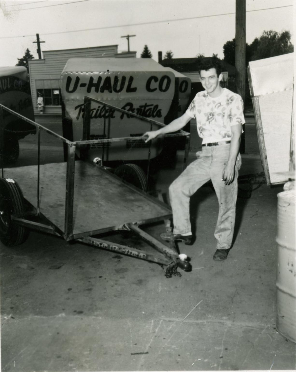 """""""Hap"""" Carty in 1946, showing off a new U-Haul trailer."""