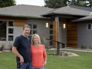 John Taylor, owner of Modern Home Design & Build, and his wife, Julie Wilcox, stand in front of The Hyfield, one of five homes included in this year's NW Natural Parade of Homes, which opens Friday and runs through Sept. 20. Taylor says his home designs are reminiscent of the midcentury architecture of Southern California.