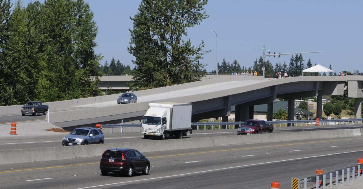 Cars use the new ramp to I-5 after WSDOT opens the new freeway interchange and the NE 139th Street bridge with a ribbon cutting at Salmon Creek in Vancouver  Wa., Wednesday August 27, 2014.