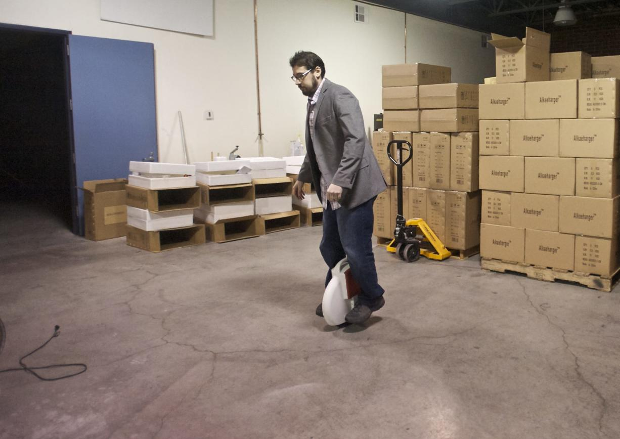 Andrew Ross, marketing director of Camas-based Inventist, Inc., demonstrates how to ride the company's Solowheel product on Tuesday. Inventist and another Camas company, Focus Designs, Inc., helped inspire a bill now moving through the Washington Legislature and sponsored by Rep.