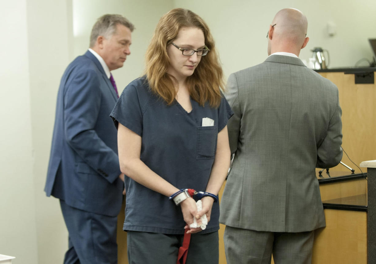 Stephanie McCrea, a former Evergreen High School drama teacher, walks back to a holding area for jail inmates after being sentenced Wednesday to five years in prison. McCrea pleaded guilty in July to having sex with a 15-year-old male student.