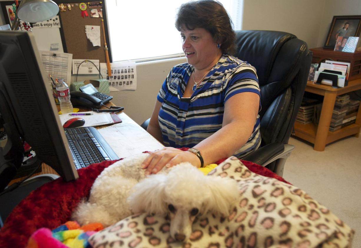 Tami Marshall has her dog Jazzy to keep her company during her workday at home. Marhsall is a medical coding specialist for Vancouver-based PeaceHealth, which allows its coders to work from home.