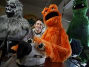 Kevin Gorby with a few of his puppets.