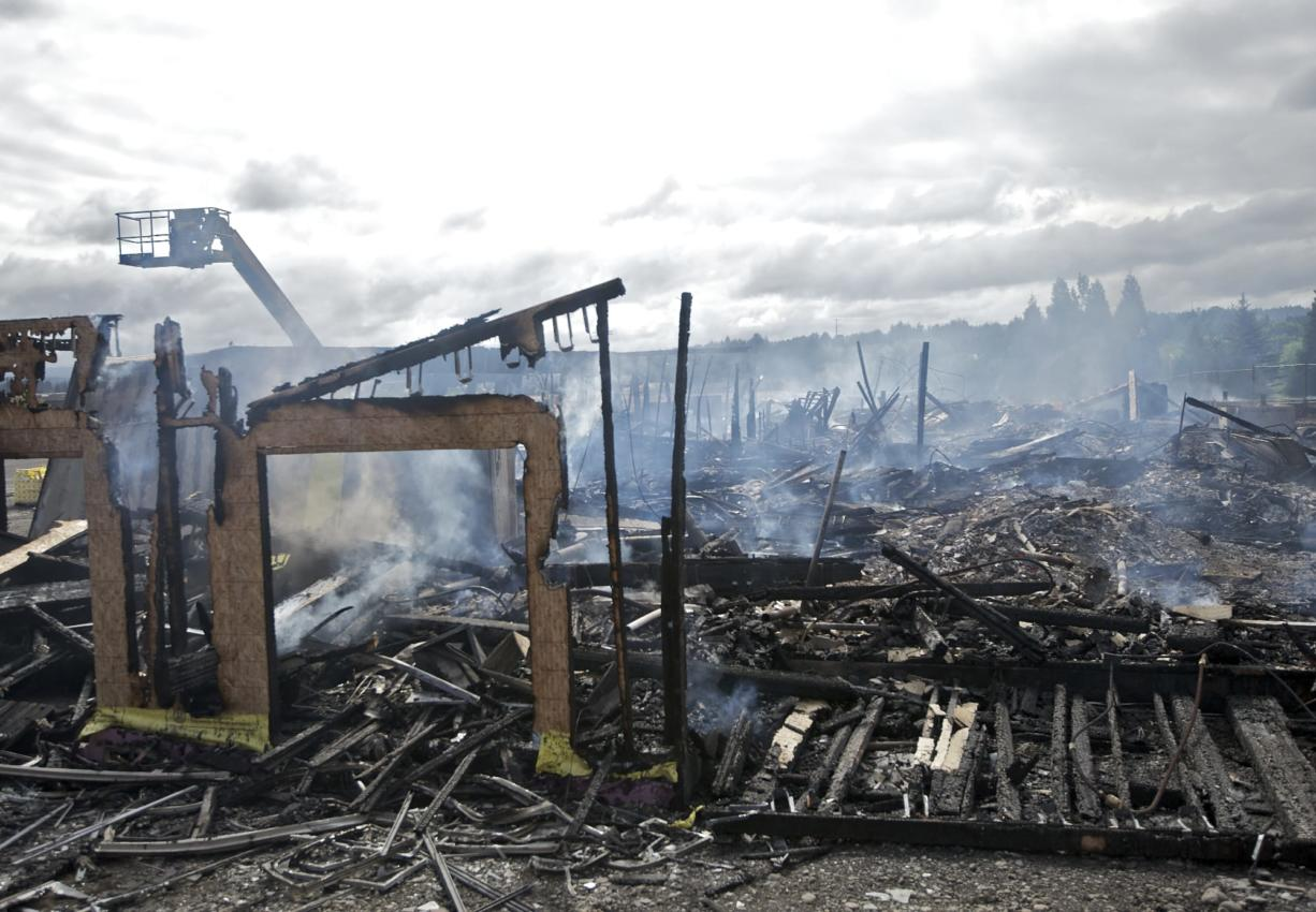 The aftermath of a two-alarm fire reported after 3 a.m. Friday, June 20, 2014, which leveled a four-story, 90-unit apartment complex in east Vancouver.