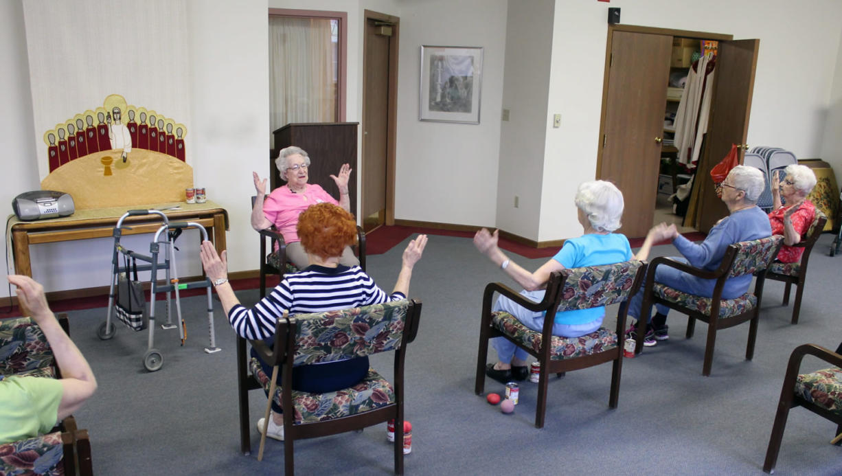 Hildegard Gigl, top, leads an exercise class at Hawthorne Terrace independent retirement center in Wauwatosa, Wis. Gigl, who turns 99 in June, is the oldest one in the class.
