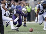 Washington wide receiver Isaiah Renfro (18) watches his fumble as California defenders Hardy Nickerson, left, Darius Allensworth and Stefan McClure (21) surround the ball during the first half Saturday, Sept. 26, 2015, in Seattle. Allensworth recovered for Cal.
