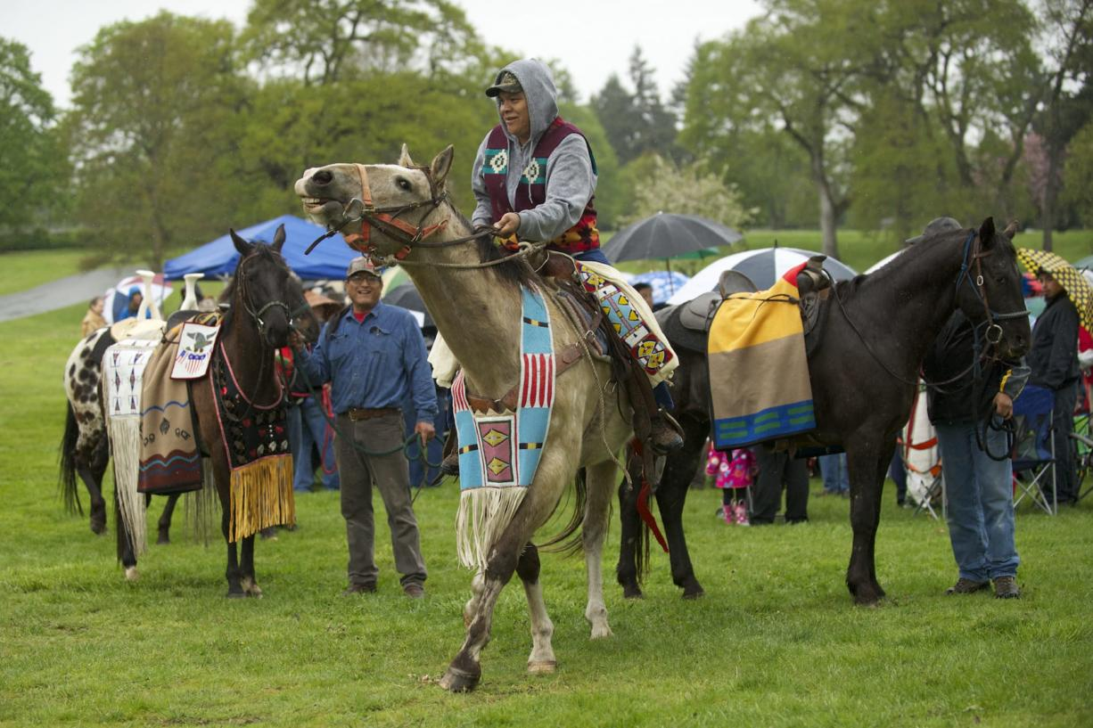 Four horses are lead around the crowd during the Riderless Horse Ceremony at the 17th Annual Nez Perce Chief Redheart Memorial Ceremony at the Fort Vancouver National Historic Site on Saturday.