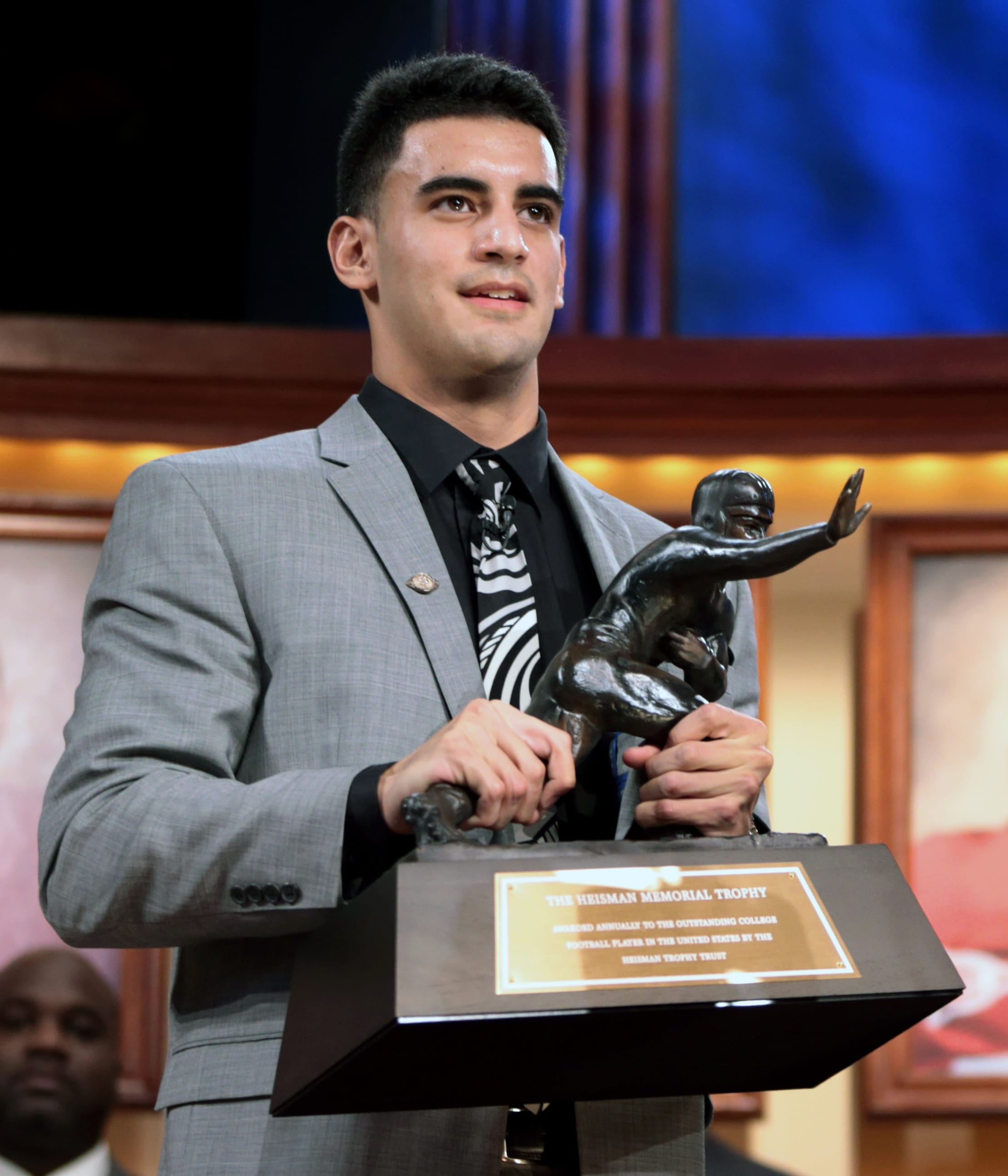 Oregon quarterback Marcus Mariota holds the Heisman Trophy after being named college football's best player during the Heisman Trophy presentation in New York on Saturday, Dec. 13, 2013. (AP Photo/Heisman Trust, Kelly Kline)