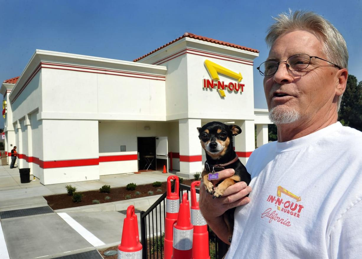 Sam Garrett and Lola of Grants Pass, Ore., are ready for Medford's In-N-Out restaurant to open Aug.