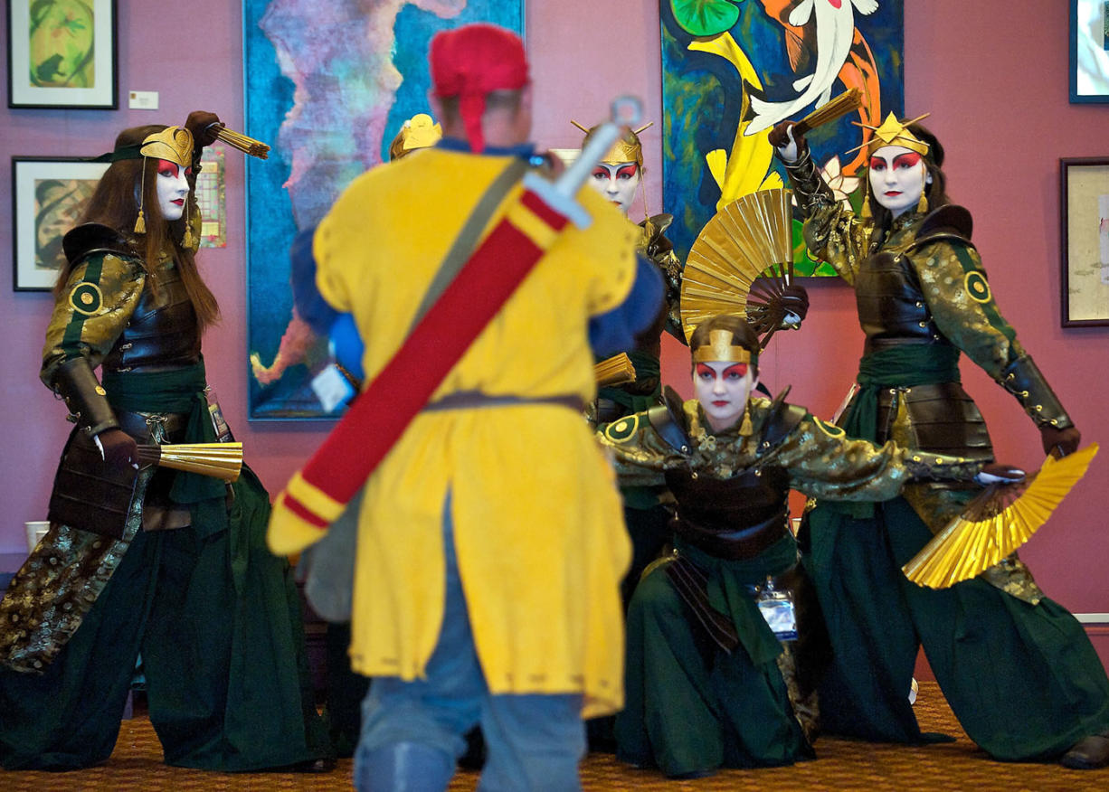 """Kumoricon attendees from Salem, Ore., dressed as Kyoshi Warriors from the Nickelodeon series """"Avatar: The Last Airbender"""" pose for a photograph in 2013."""