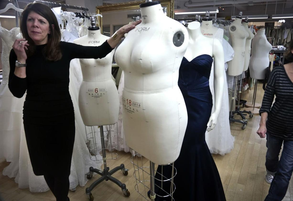 David's Bridal senior vice president Michele von Plato shows a plus-size mannequin in New York.