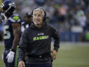 Seattle Seahawks head coach Pete Carroll smiles on the sidelines during in the first half of a preseason NFL football game against the Oakland Raiders, Thursday, Sept. 3, 2015, in Seattle.