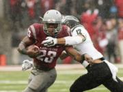 Washington State running back Gerard Wicks (23) runs against Portland State safety Walter Santiago (12) during the first half of an NCAA college football game, Saturday, Sept. 5, 2015, in Pullman, Wash.