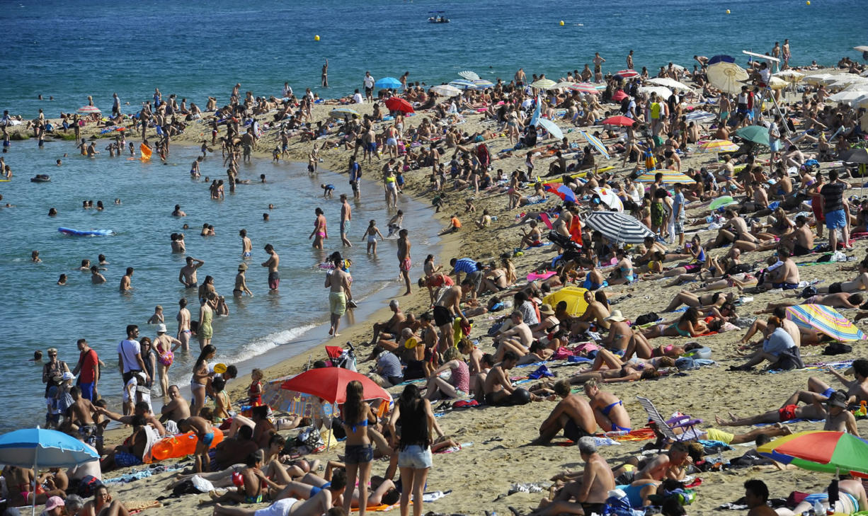 People relax on the beach on July 17 in Barcelona, Spain.