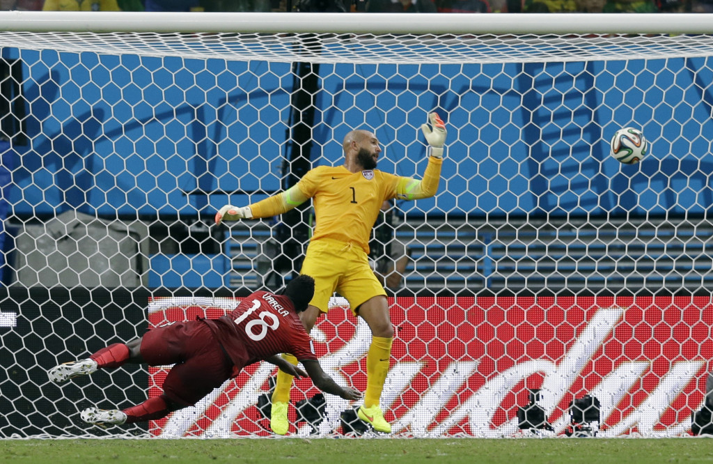 Portugal S Silvestre Varela Heads The Ball Past United States Goalkeeper Tim Howard To Sc