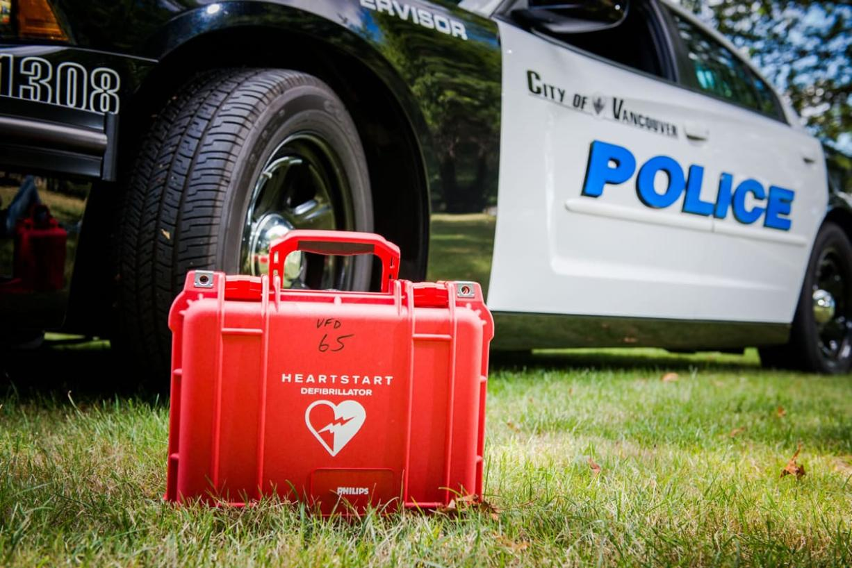 Vancouver police say they've saved their first life since all of its patrol cars were equipped with automated external defibrillators.