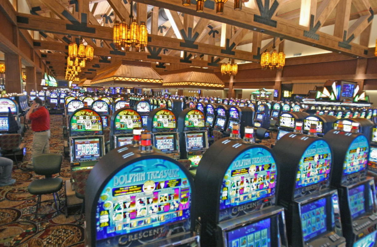 The state gambling commission has approved a compact allowing the Cowlitz Tribe to start sharing in gaming revenues with other tribes.