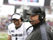 Portland State head coach Bruce Barnum, right, watches during the first half of an NCAA college football game against Washington State, Saturday, Sept. 5, 2015, in Pullman, Wash.