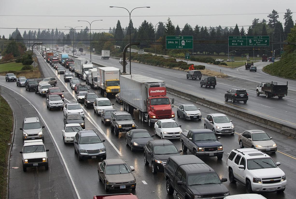 Traffic congestion is on the rise in the Vancouver area, according to a state report released Monday. Commuters racked up nearly 52,000 hours in delays in 2014, a 28 percent increase from 2012. (Amanda Cowan/The Columbian)