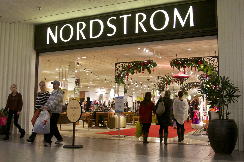 76660ad10b Shoppers leave Nordstrom at the Westfield Vancouver mall on Black Friday.  The store closed Saturday
