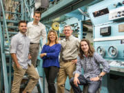 In an era marked by corporate ownership of newspapers, The Columbian has remained family owned and operated under the leadership of the Campbell family for generations. From left, Ben, Will, Jody, Scott and Ross Campbell pose in The Columbian's press room.