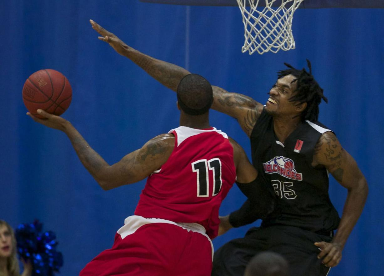 Vancouver Volcanoes center Gjio Bain (R) defends against Portland Chinooks forward Kevin Ford (L).