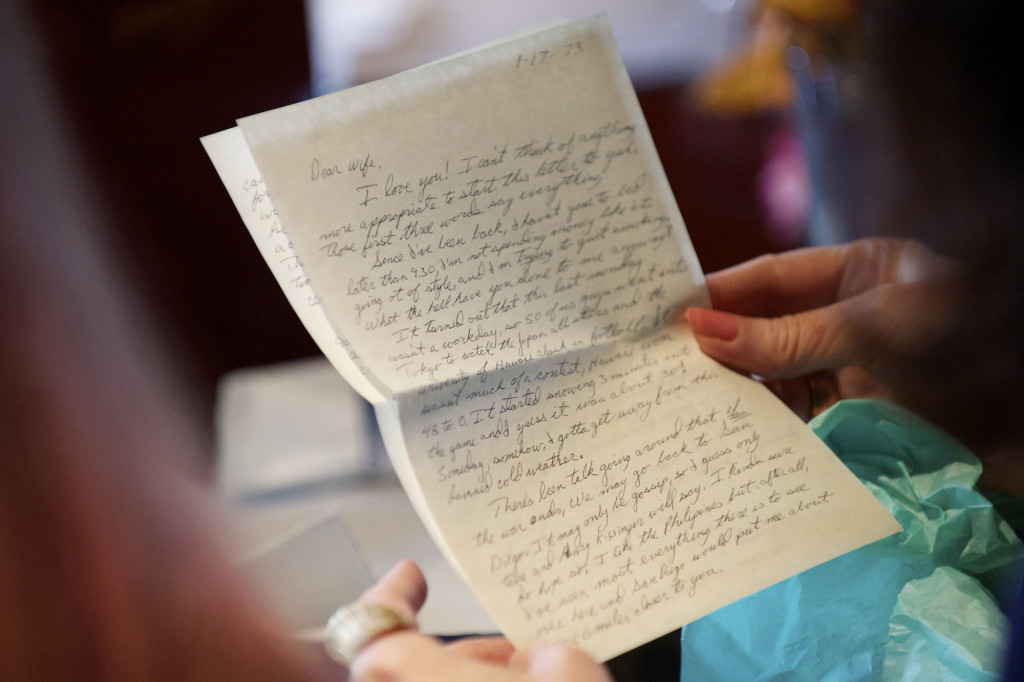rose hill looks at letters written by her husband a childhood friend she married while