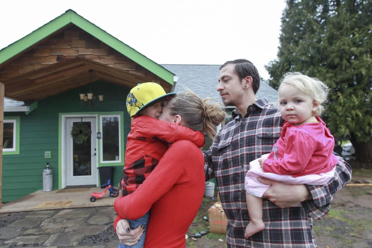 Patricia Kent and Dillon Haggerty, pictured with their son, Quintin, and daughter, Cadence, spent the last year renovating a dilapidated farmhouse into their dream home using natural building practices.
