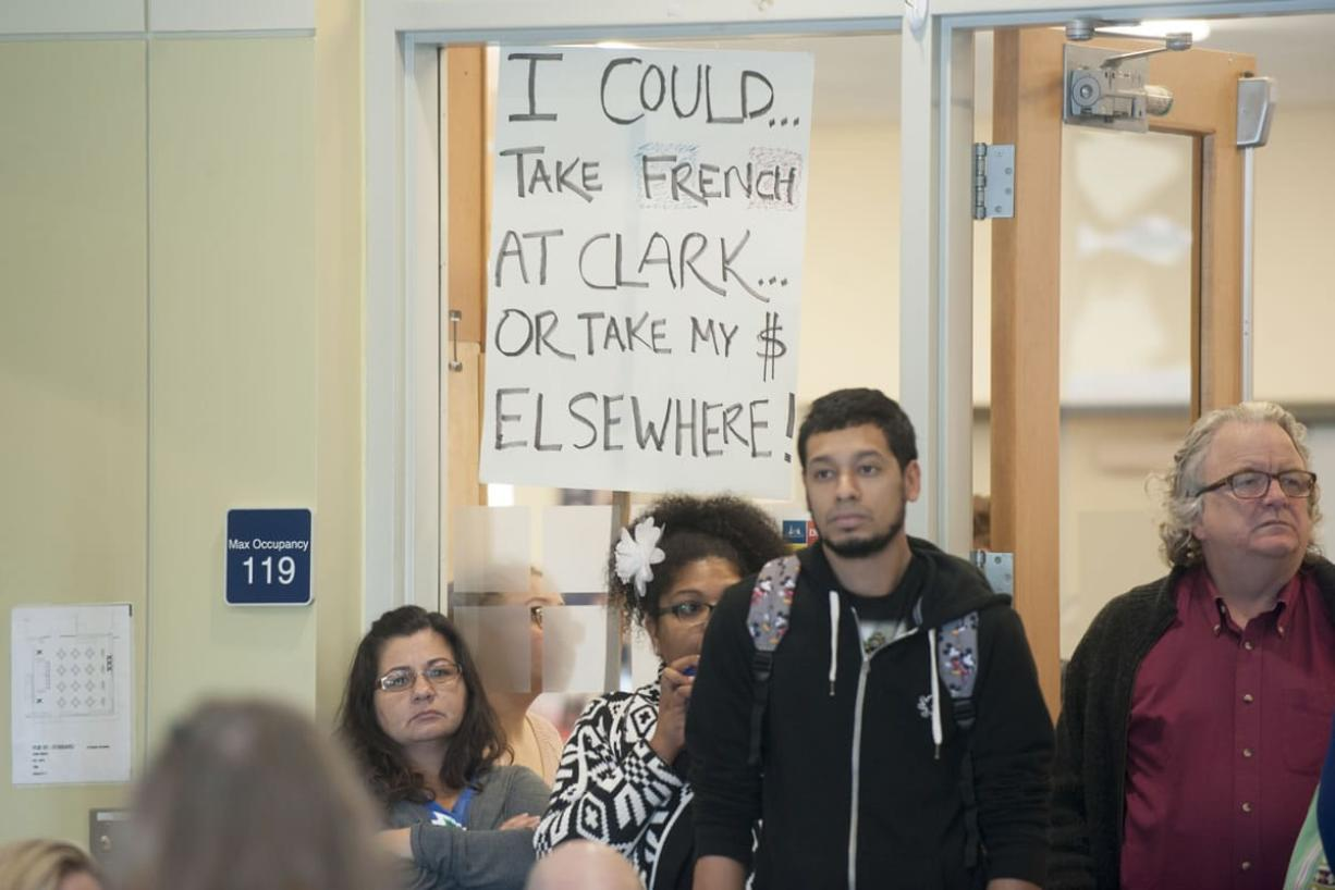 French students protest proposed budget cuts that would eliminate the French program during a forum Thursday at Clark College. (Natalie Behring/The Columbian)