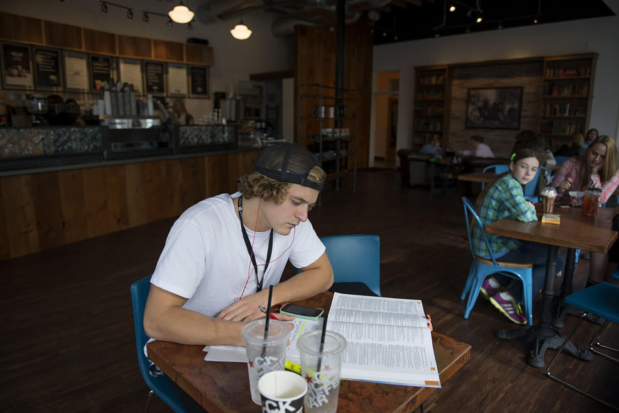 Igor Shapoval, a nursing student at Clark College, works on homework Friday afternoon at Black Rock Coffee in downtown Vancouver.