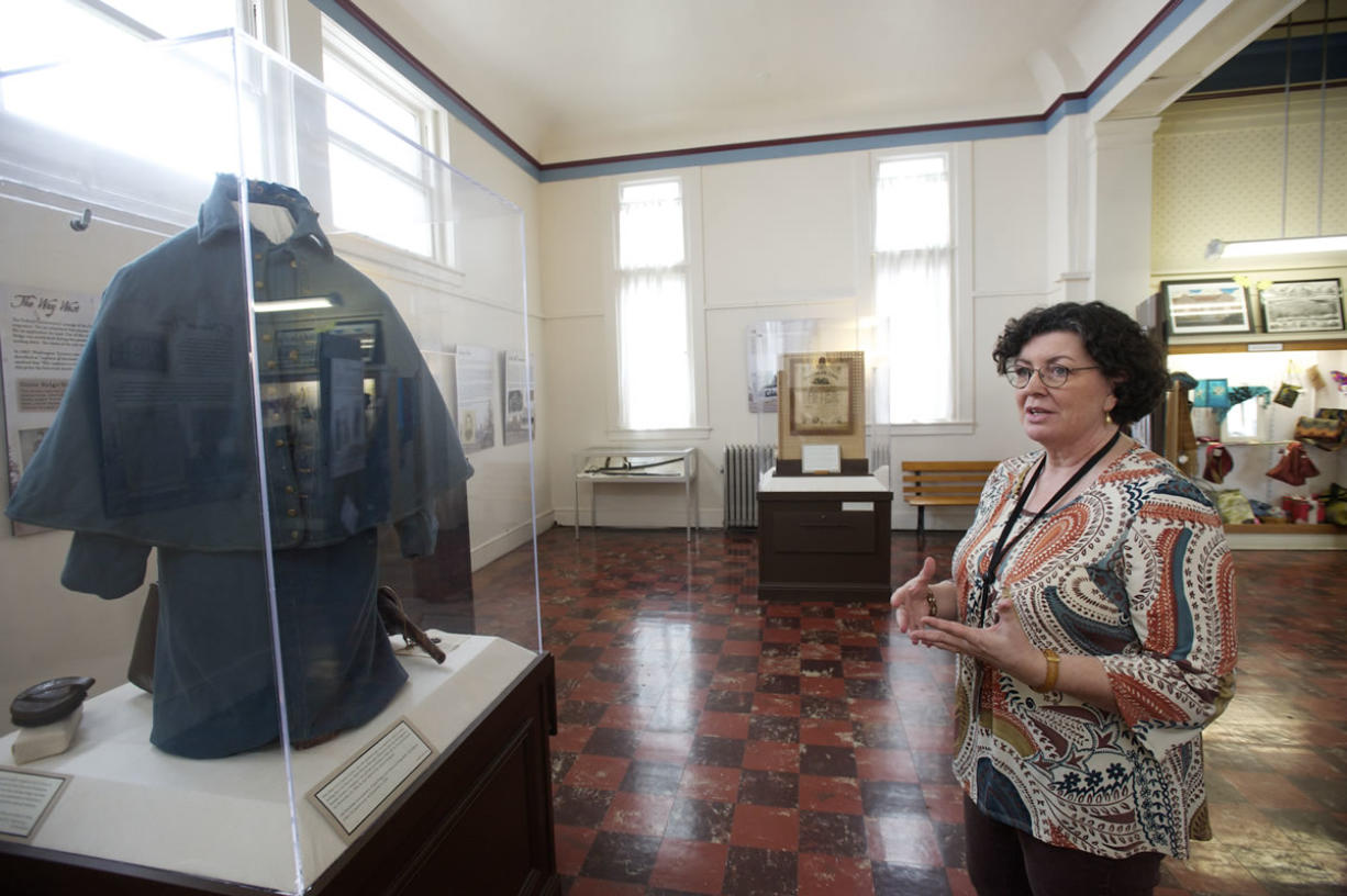 Kris Wells, museum collections manager, describes Civil War exhibits, including Albert Marion Edmonds' Union cavalry coat. Top: Lewis Sutton writes about Gen. Sherman's march through Georgia in his Civil War diary.