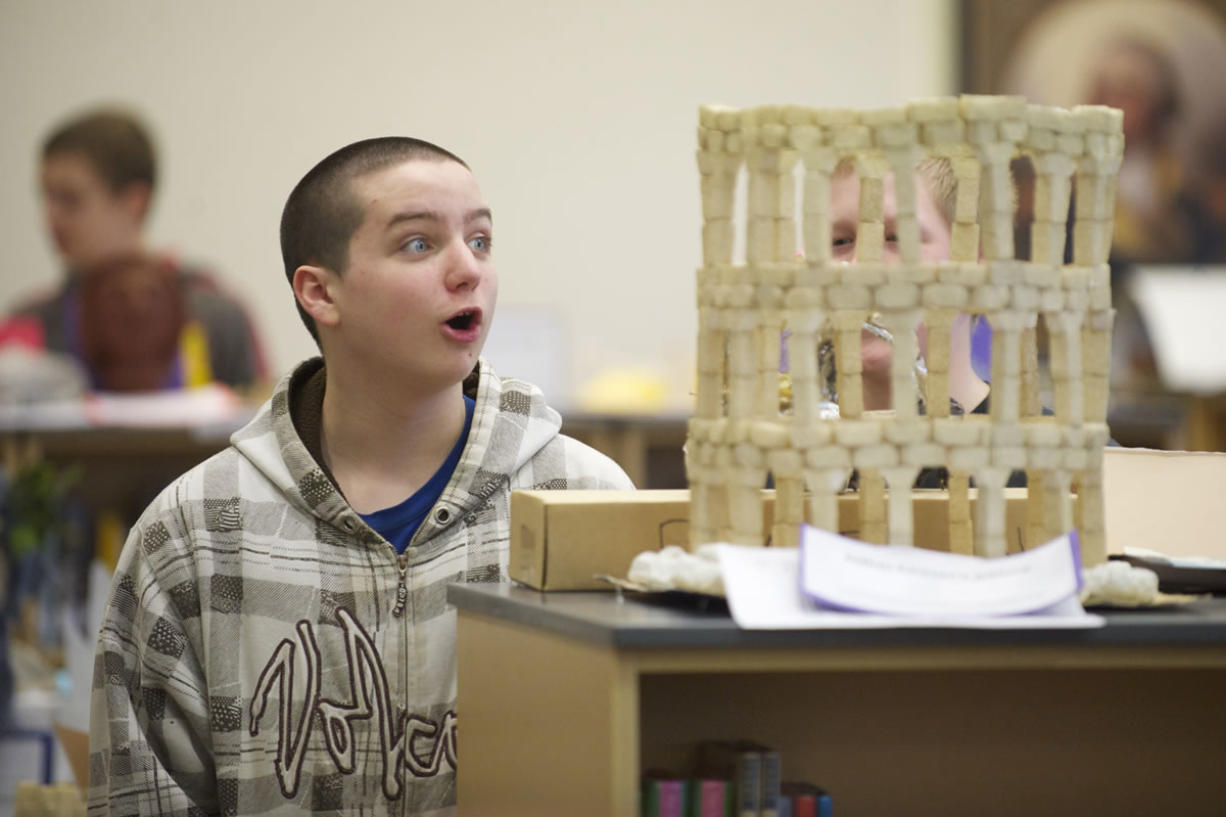 Photos by Steven Lane/The Columbian Liberty Middle School seventh-grader Brighton Ford looks at a foam model of ancient Roman architecture.