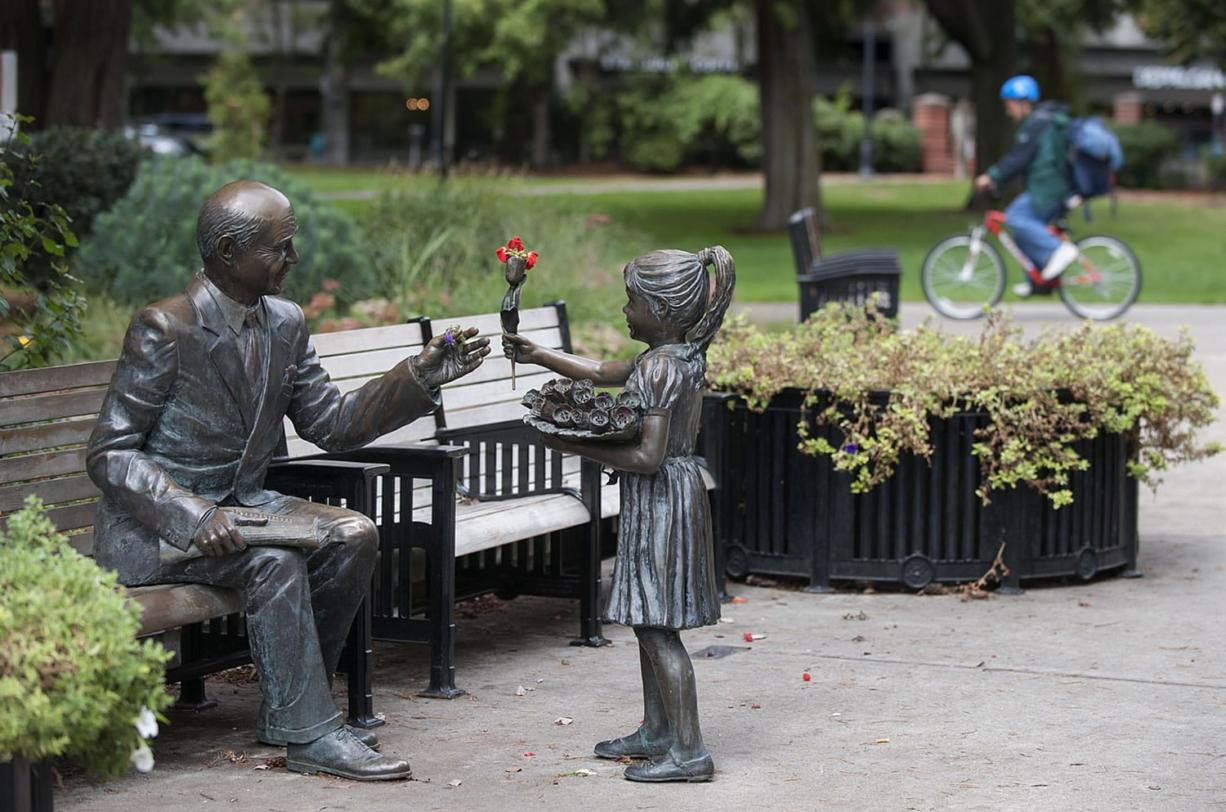 The Columbian's history is intertwined with the community that it has served for 125 years. A statue in Esther Short Park, Vancouver's outdoor living room, reflects the relationship between the newspaper and its community in depicting a man with a copy of The Columbian on his lap  as he greets a young girl.