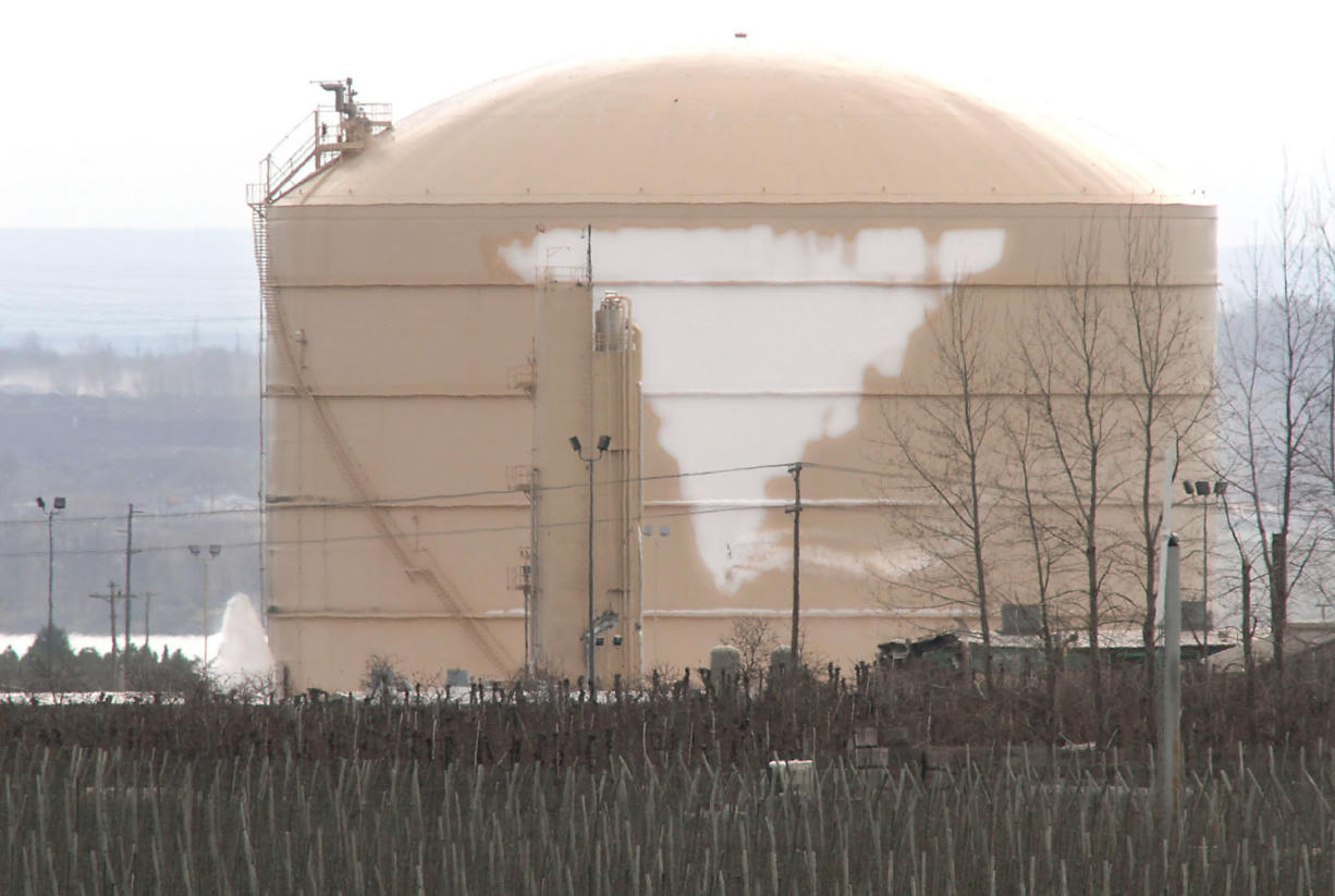 Liquefied natural gas vapors continue to leak Tuesday, leaving a frosty coating on the damaged storage tank at the Williams Northwest Pipeline facility near Plymouth.