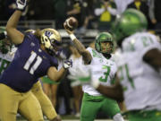 Oregon quarterback Vernon Adams Jr. (3) passes as Washington's Elijah Qualls (11) is blocked in the first half of an NCAA college football game, Saturday, Oct. 17, 2015, in Seattle. (AP Photo/Ted S.