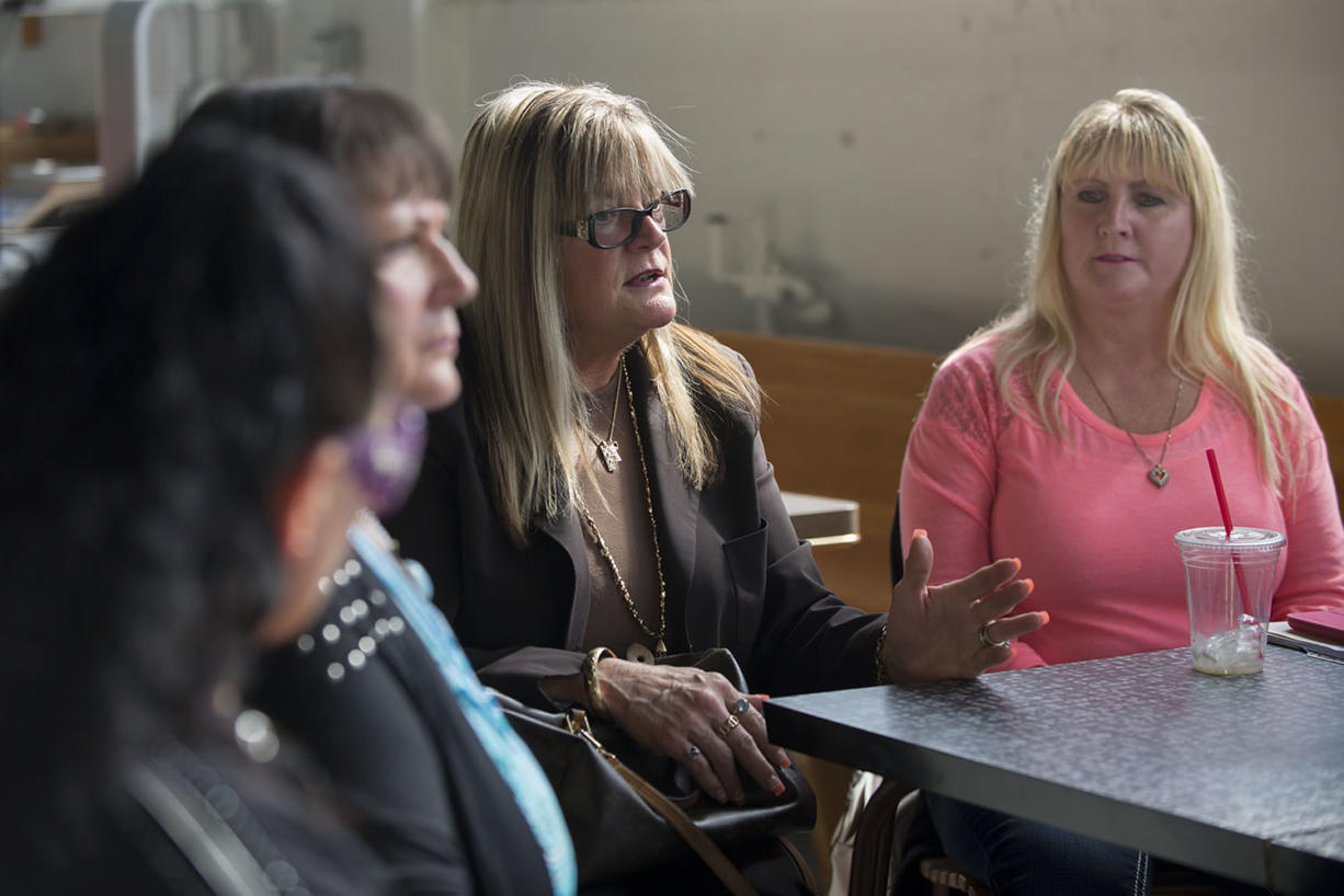 Kimberly Quigley, center, longtime Red Lion Hotel Vancouver at the Quay banquet captain, shares her feelings about the Spokane-based chain's decision not to offer severance to part-time employees who will lose their jobs after the hotel complex closes at day's end on Oct. 31. Fellow employee Cyndee Ball, right, looks on at Torque Coffee.