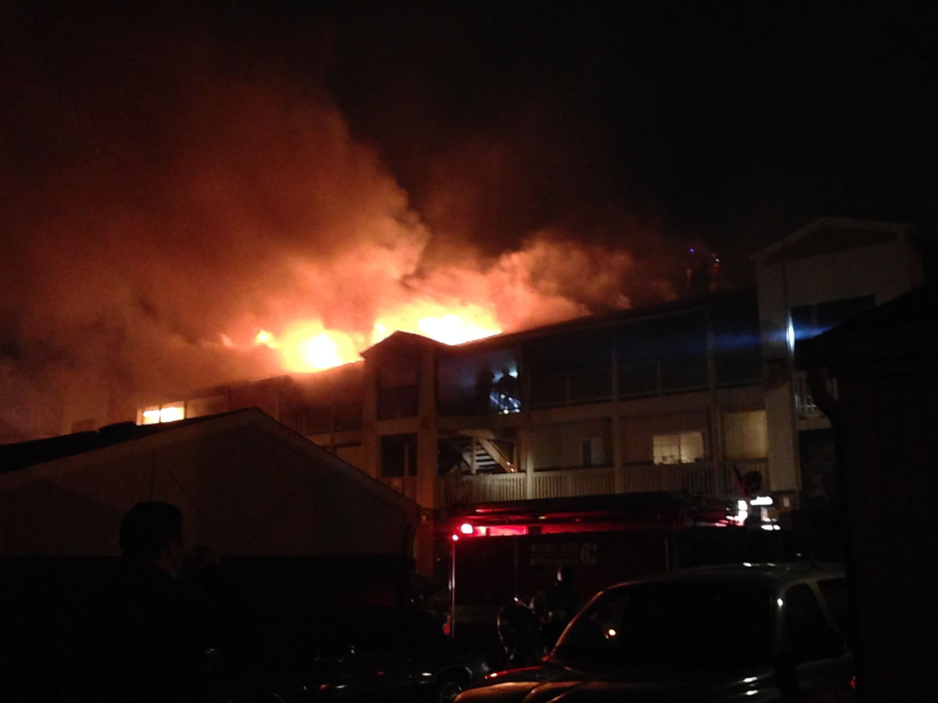 Flames lick from Building M at the Bridge Creek Apartments this morning.