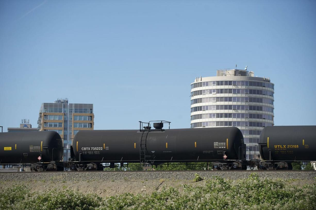 An oil train passes through downtown Vancouver.