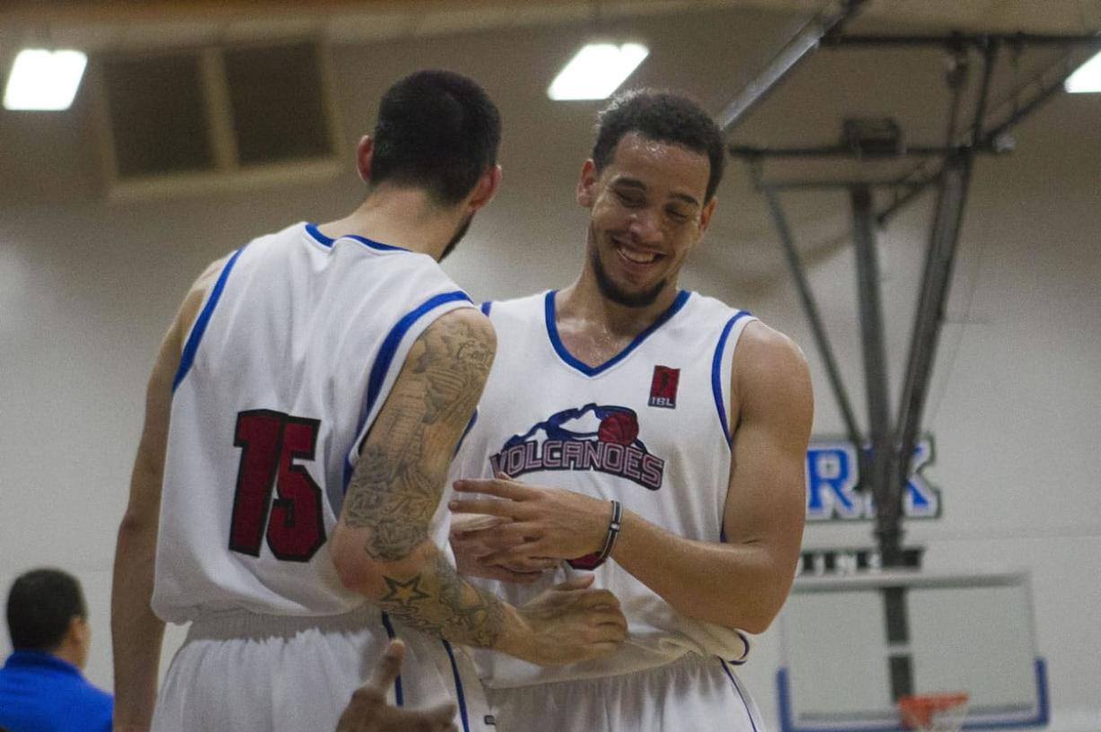 Chehales Tapscott, right, in his final home game for the Vancouver Volcanoes