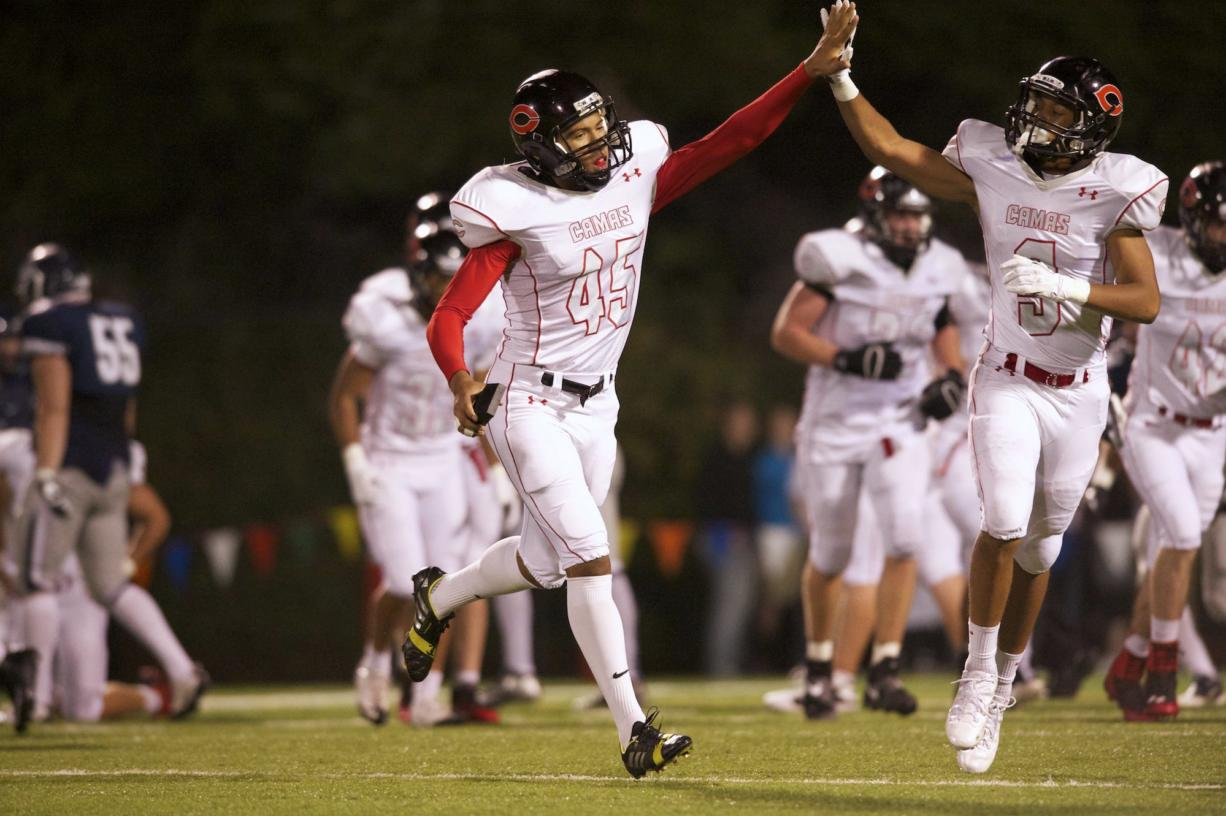 Kicker Caleb Lightbourn, #45, is congratulated after a field goal against Skyview, October 4, 2013.