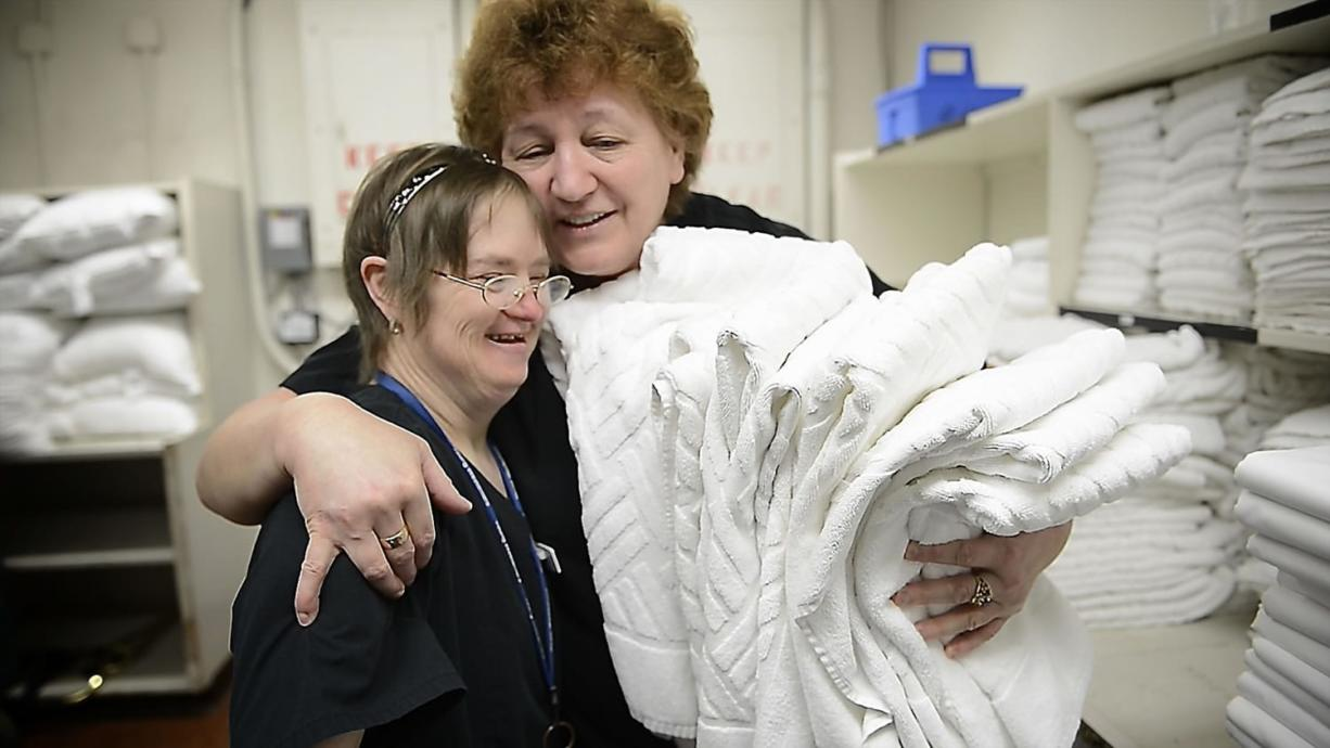 Shelli Fanning, left, shares a hug with supervisor Vera Babiy on Fanning's last day of work at the Red Lion Hotel Vancouver at the Quay. Fanning has Down syndrome but family and professional support helped her succeed at her housekeeping job for 23 years. Babiy said that whenever Fanning arrived at work, it was like the sun coming out.